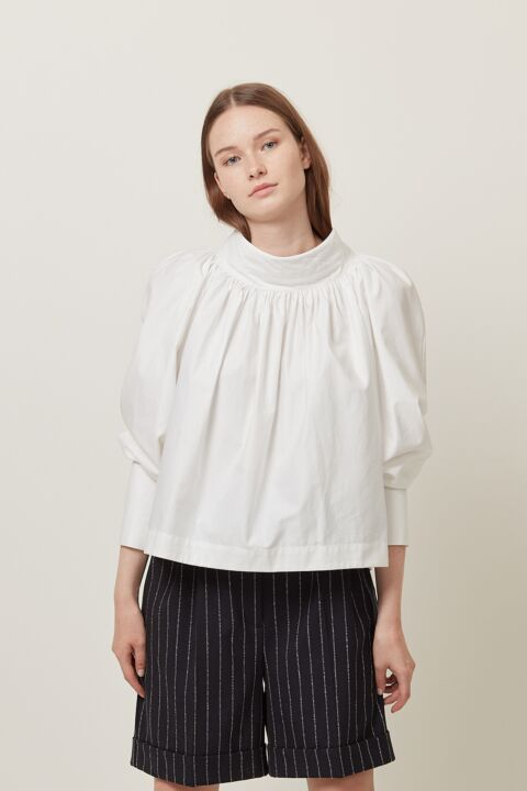 Gathered blouse with high coll